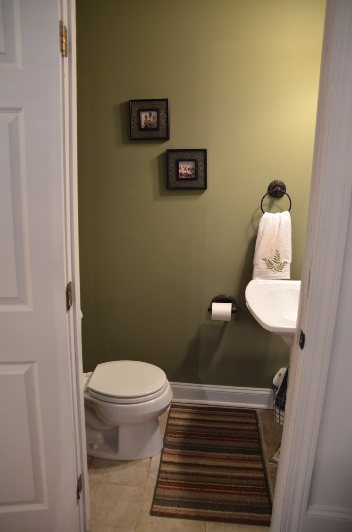 Half bath update home stories a to z for Toilet decor pictures
