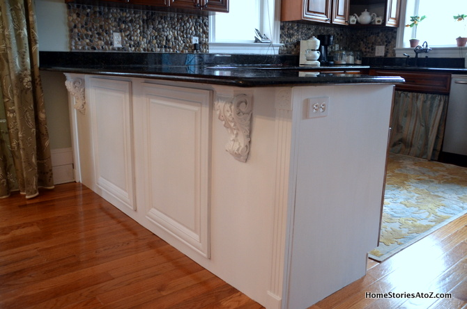 white painted kitchen island black counters