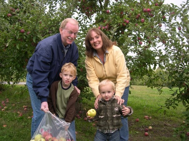 mom and dad apple picking
