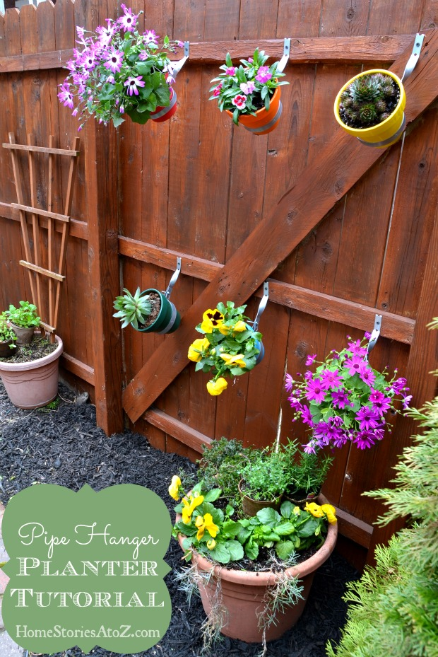 Urban garden do it yourself fence planter home stories - Flower pots to hang on fence ...
