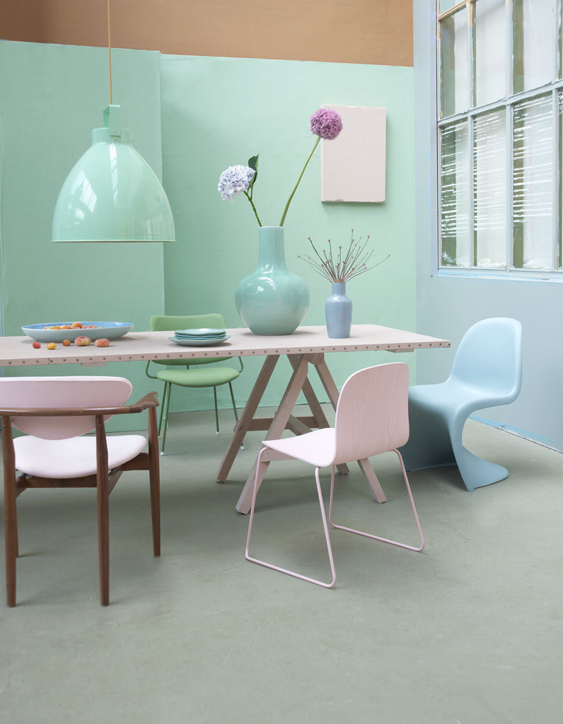 pastel chairs around table