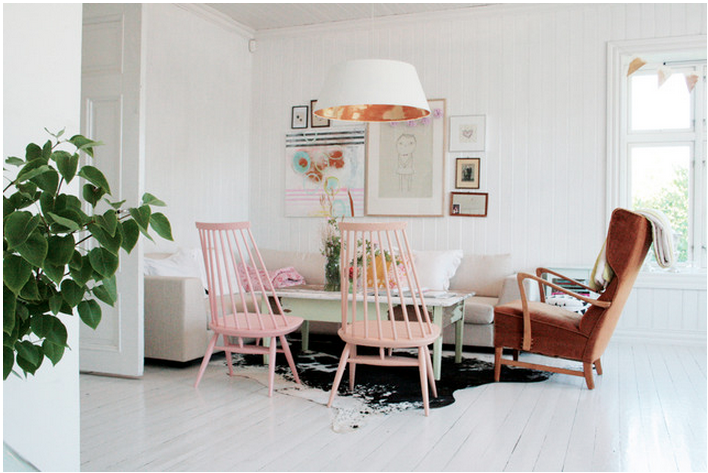 pastel pink chairs around table