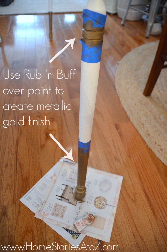Rub 'n Buff to create gold table legs.