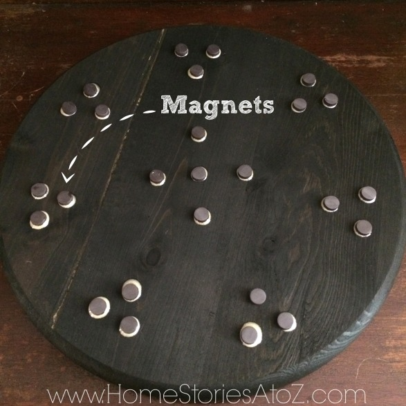 Glue magnets to lazy susan for easy container removal.