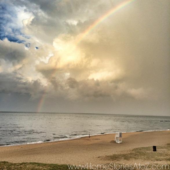 rainbow over beach and bay