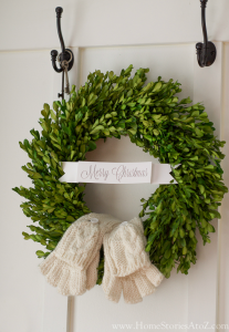 Place mittens on boxwood wreath for a fun decoration