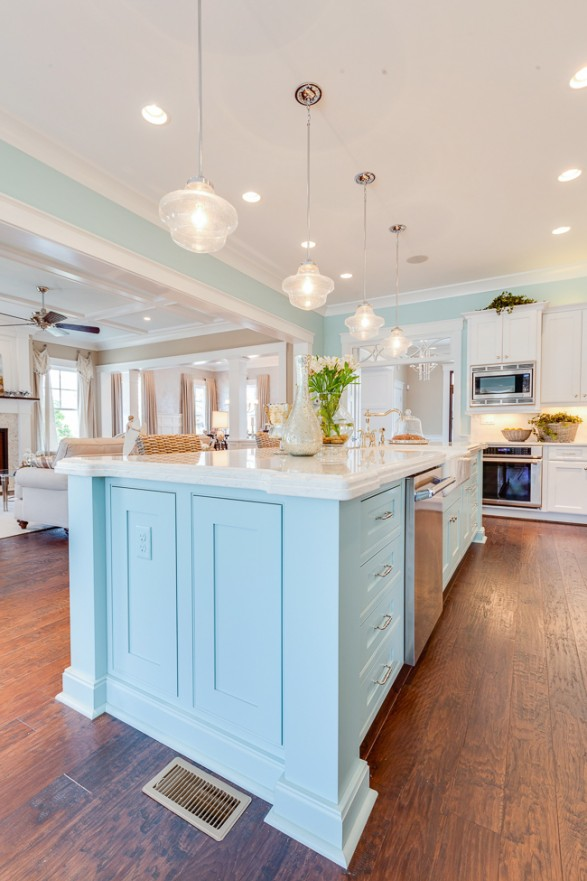 Coastal kitchen home stories a to z for Kitchen cabinets lowes with sea themed wall art