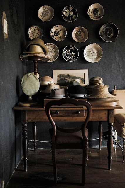Hang plates on wall. Love the black wall