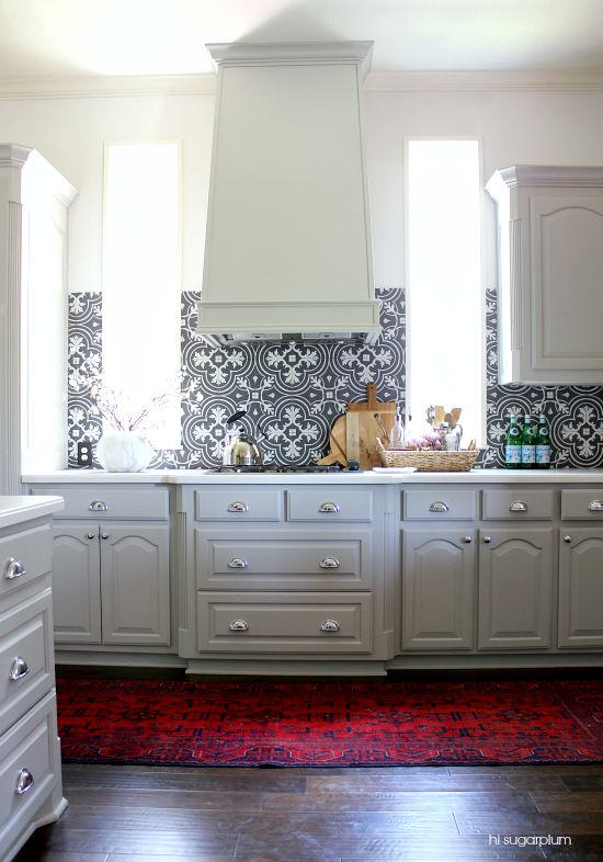 white kitchen hood gray kitchen cabinets