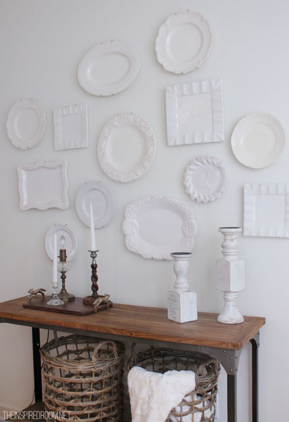Hang white plates on wall. Easy and inexpensive decorating with plates