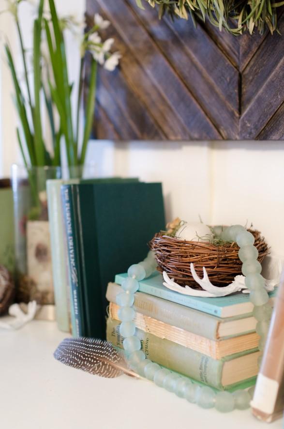 Spring mantel ideas. Birds nest and books mantel