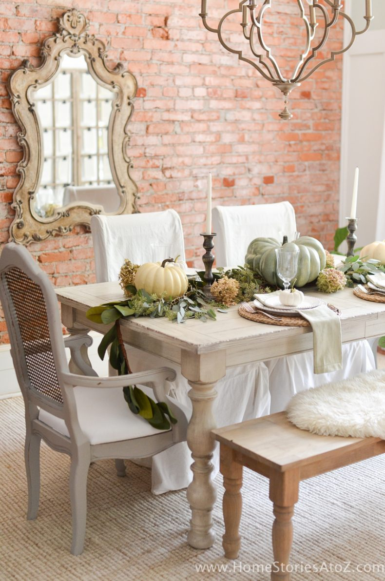 Beautiful fall table decorations! Love the brick wall.