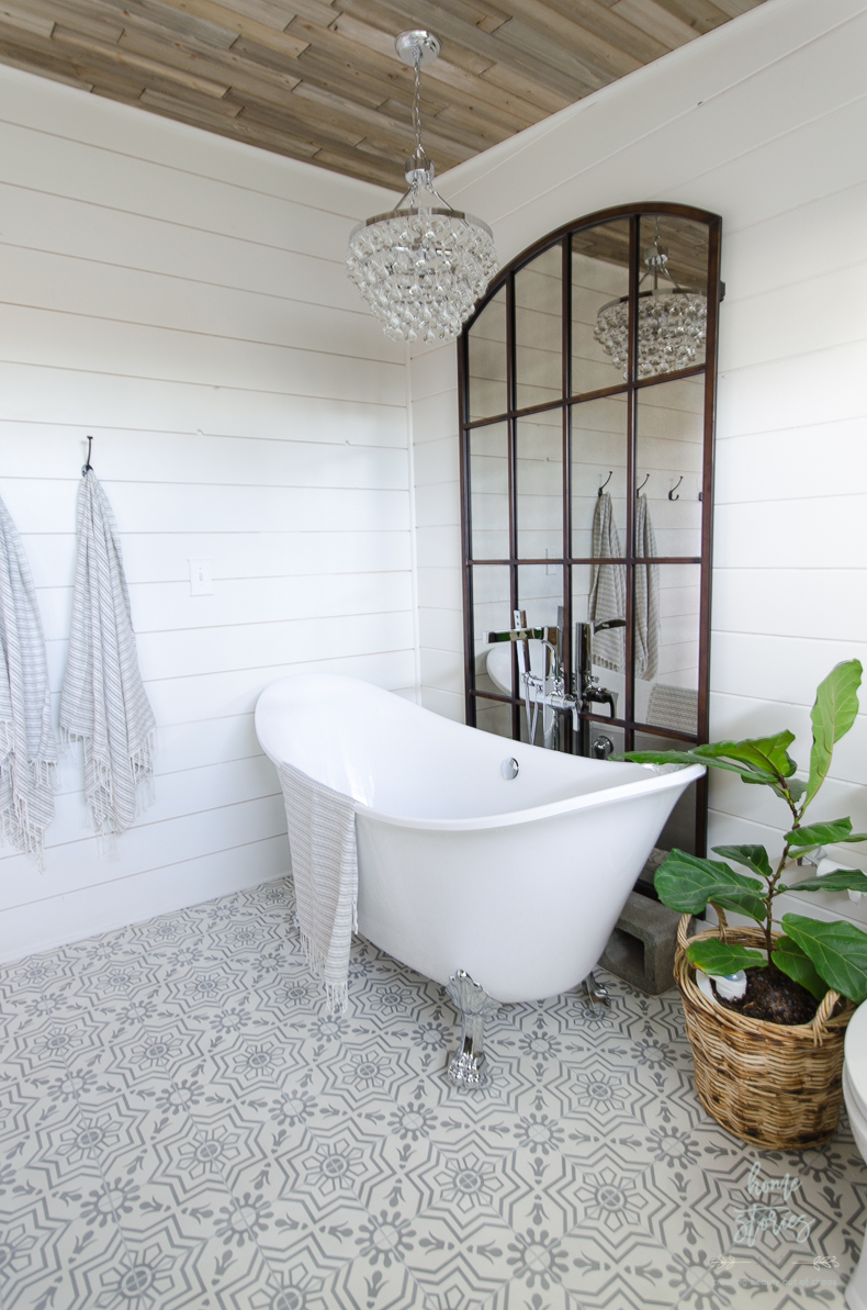 The Plank Ceiling Shiplap Walls Grid Mirror Cement Tile And Raindrop Chandelier Provide A Perfect Backdrop For My Double Slipper Tub