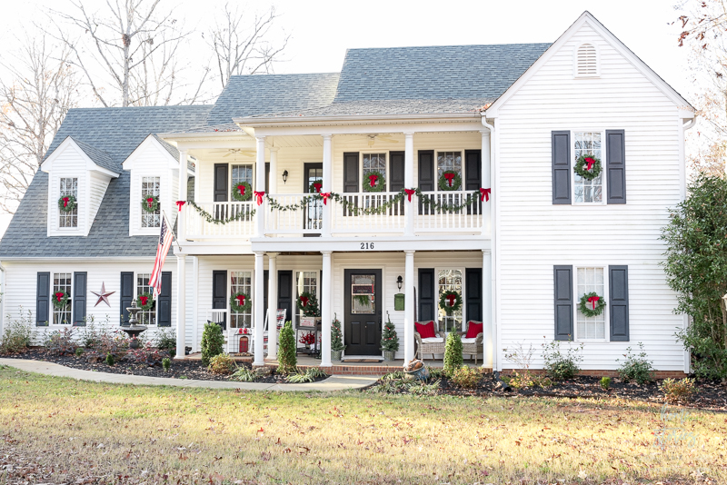 classic red and green christmas exterior white house black shutters