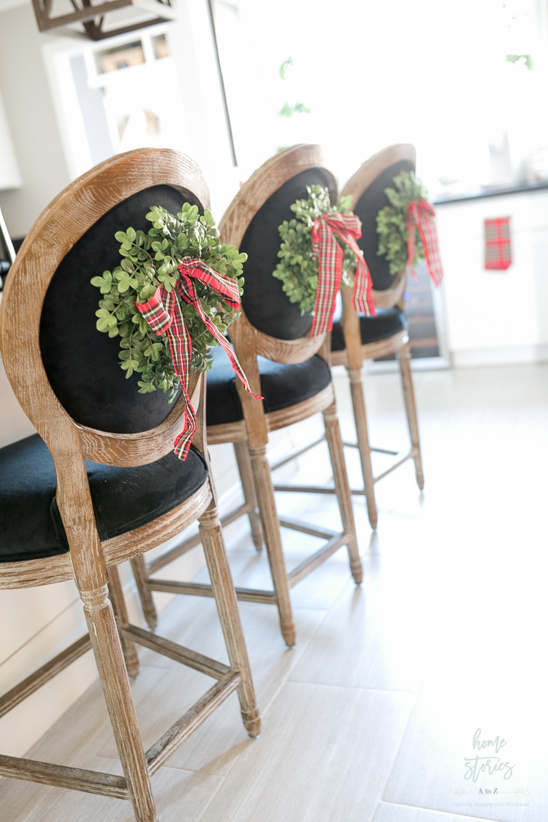 wreaths on back of chairs