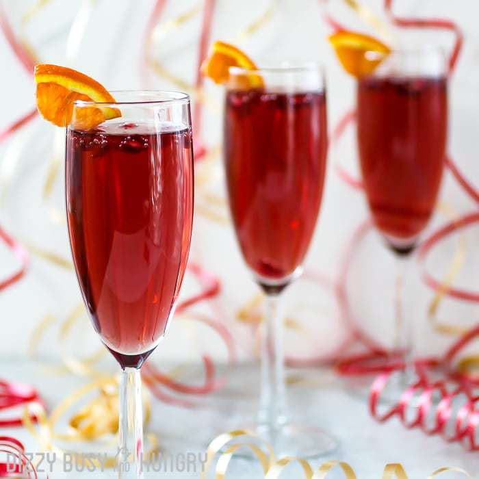 Boozy Holiday Cocktails - Pomegranate Orange Spritzer by Dizzy Busy and Hungry