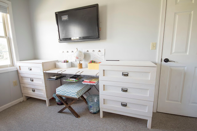 Creative way to fit in storage and a desk for kids sharing a small room!