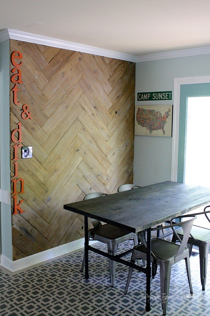 Tasha's bamboo flooring was damaged, and she chose a modern stencil and went right over that damage with several layers of paint. Full tutorial in this post, and very helpful with anyone painting over wood flooring.
