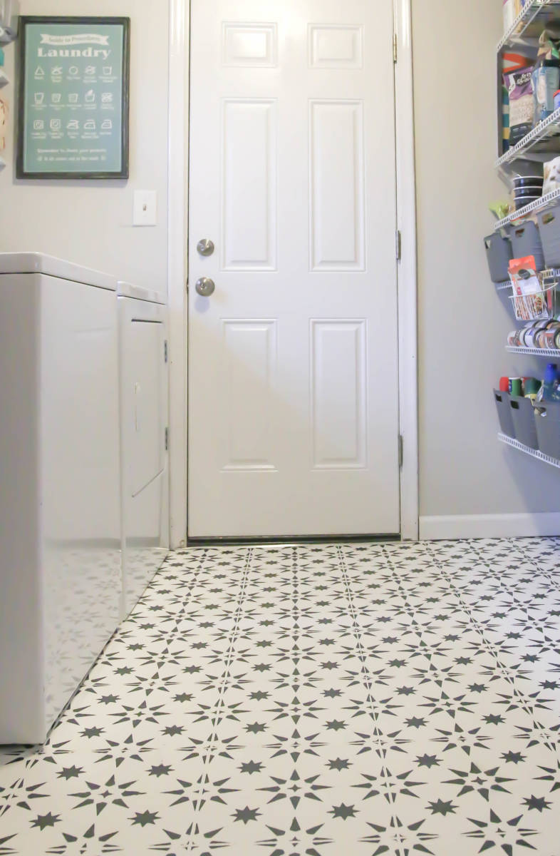 Show stopper! This laundry room floor was originally a standard type of beige linoleum, and look at her now! Gorgeous. Sarah used a specific type of paint that is great for heavy traffic in her laundry room.