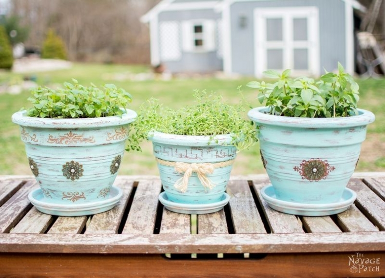 Unique Container Garden Ideas for your Porch or Patio - Refinishing Old Flower Pots by The Navage Patch
