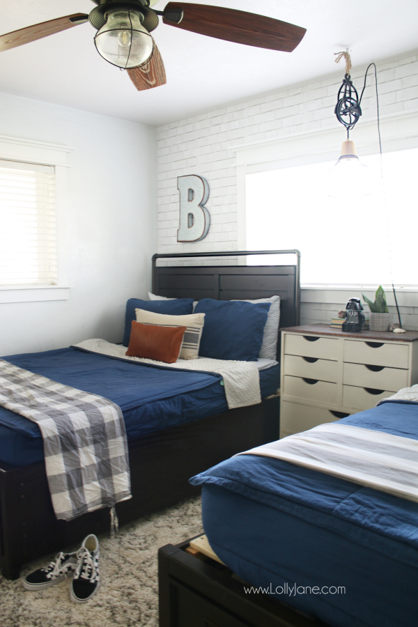 Gorgeous Blue Bedroom Decor Ideas - Boys' Bedroom with Brick Wallpaper by Lolly Jane