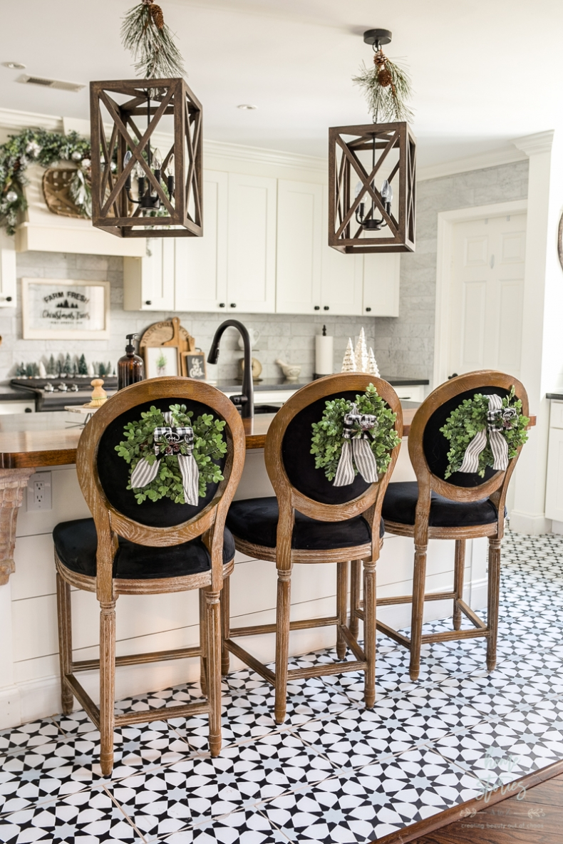 Beautiful and Easy Christmas Decor Ideas - Hang a wreath on your chairs - Home Stories A to Z