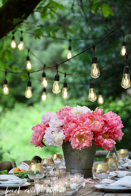 Entertaining Outdoors Using String Lights - Gorgeous Outdoor Dining by French Country Cottage