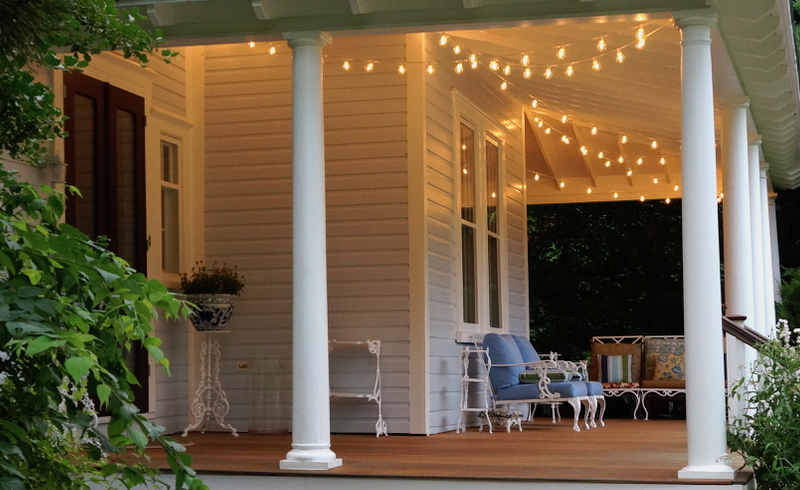 Entertaining Outdoors Using String Lights - Gorgeous Porch with String Lights by Victoria Elizbeth Barnes