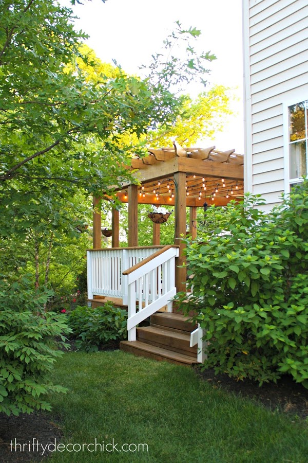 Entertaining Outdoors Using String Lights - Pergola with String Lights by Thrifty Decor Chic