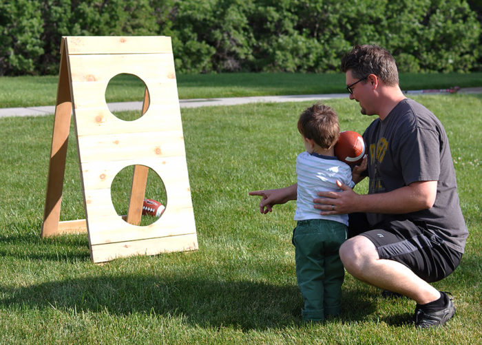 Fun Outdoor Games - DIY Football Toss Game by Cherished Bliss