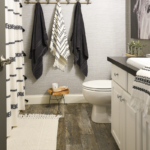 Budget Friendly Bathroom Renovations and Decor Tips- Boho Farmhouse Bathroom by Home Stories A to Z