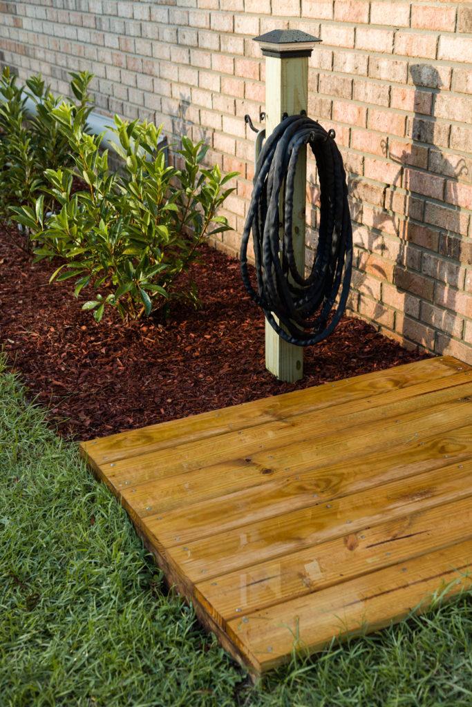 DIY Backyard Projects - DIY Garden Hose Holder by Kippi At Home