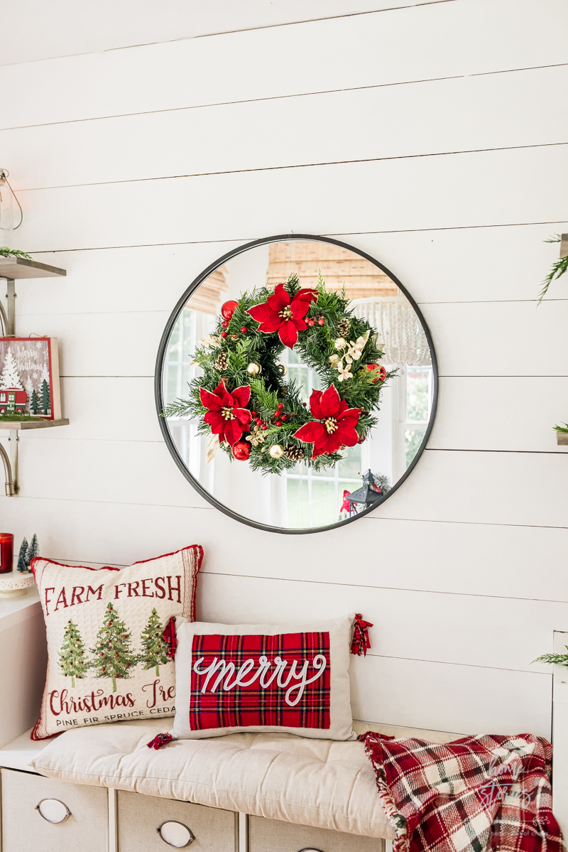 Christmas wreath with red poinsettias
