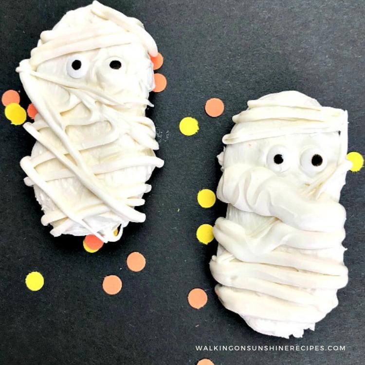 21 Halloween Treats - Nutter Butter Mummy Cookies by Walking on Sunshine