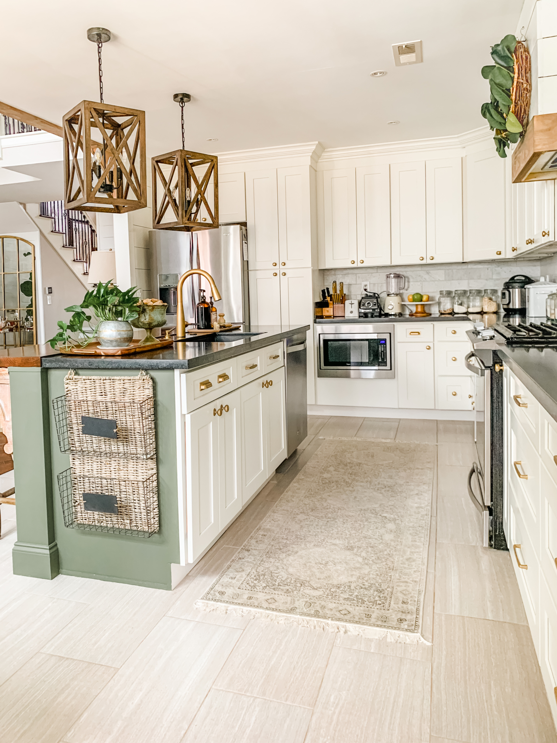 white cabinets with green kitchen island and wood accessories