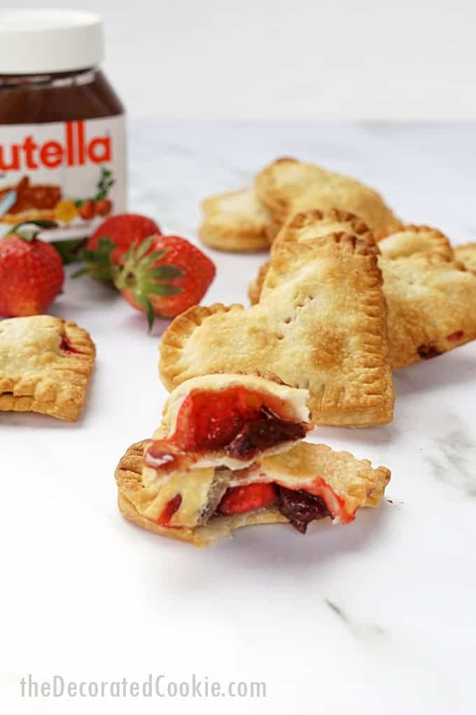 Strawberry Recipes - Strawberry Nutella Hand Pies Air Fryer by The Decorated Cookie